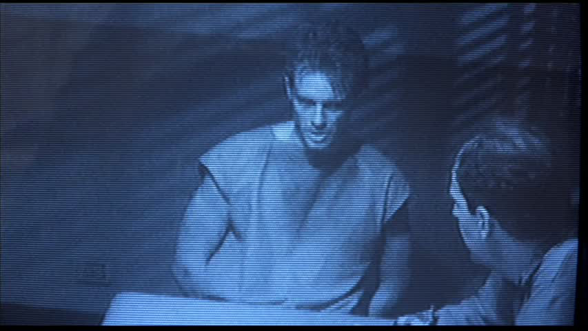 On A Television Monitor Tape Plays Kyle Reese Sits Handcuffed To
